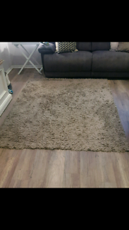 Grey shaggy floor rug
