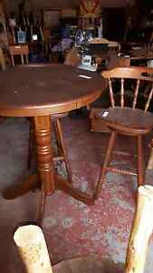 Bar table and swivel chairs