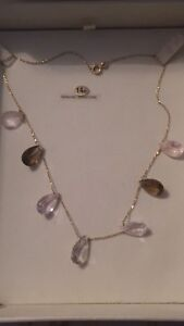 14 KT yellow gold necklace with 7 good stones with $2000