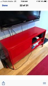 Red metal media stand