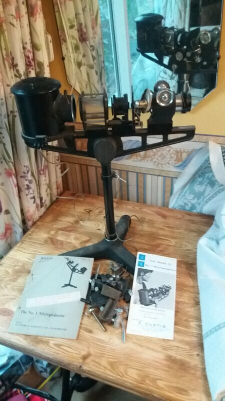 Antique Flatters and Garnett Microprojector microscope.