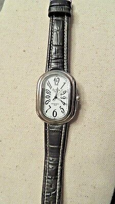ACTIVA Vintage Woman's Wristwatch, Large Case. Silver Tone, Black Leather Band.