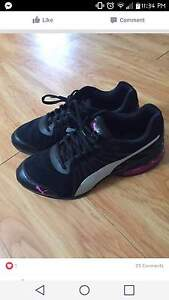 Puma sneakers, call or text 902-642-1858