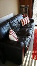 2 x brown leather lounge.rug and pillows 2 side tables Long Jetty Wyong Area Preview