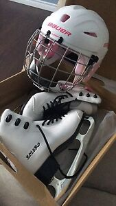 Youth ice skates and helmet
