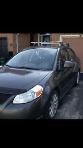 Suzuki SX4 with cold air Condition two pear of tires on Rim