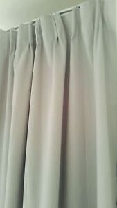Pleated light grey blockout curtains