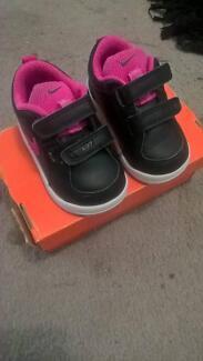 """Baby Girl """" Nike """" Shoe."""