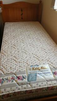 a single bed with mattress