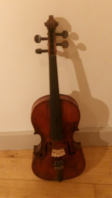 A vintage violin in wooden case with unstrung bow