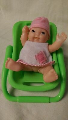 TINY MINI BABY DOLL DRESSED IN PINK WHITE PINK HAT GREEN CAR SEAT new