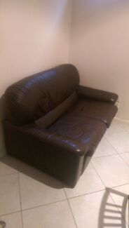 Lovely brown leather lounge suite with two footstools  Kensington Melbourne City Preview