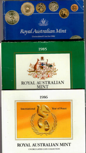 Australia 1984, 1985, and 1986 Uncirculated coin sets in folders