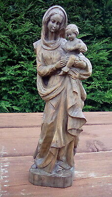 Hand carved wooden statue of mary and child