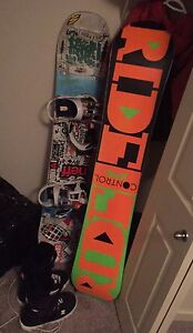 2 snowboards for sale with boots and bindings