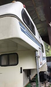 Bigfoot 9.5 camper with air conditioner