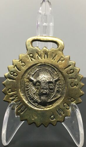 1873 - 1973 N.W.M.P.-R.N.W.M.P.-R.C.M.P. SOLID BRASS COMMEMORATIVE BRIDLE BADGE