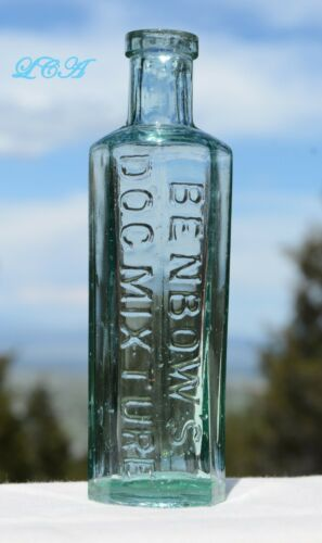 ORNATE antique DOG MEDICINE embossed bottle nice TURQUOISE AQUA MARINE color