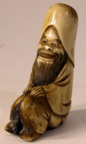 Japanese 19th century stag antler carved NETSUKE depicting the God Fukurokuju