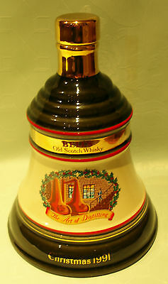 "A ""BELL'S"" OLD SCOTCH WHISKY ""CHRISTMAS 1991"" DECANTER IN SUPERB CONDITION."