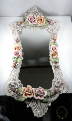 Vintage porcelain wall mirror with roses.