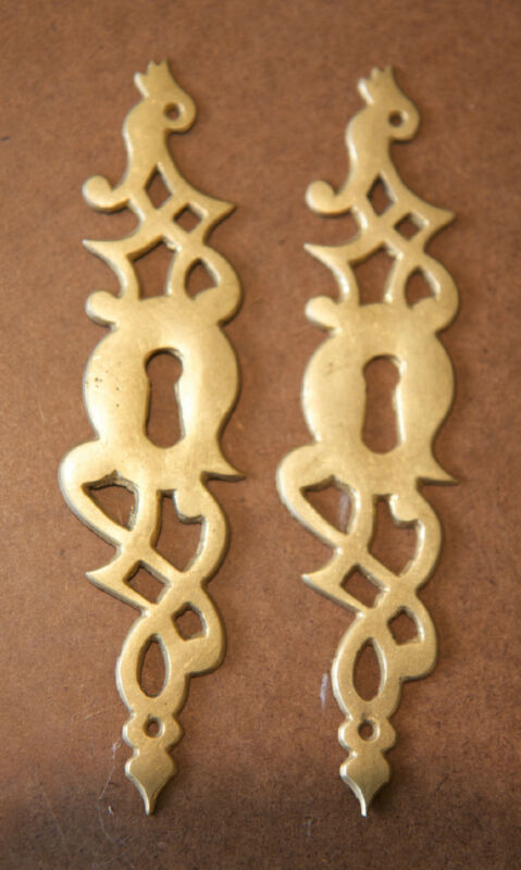 A Pair of Large Cast Brass Chippendale Escutcheons
