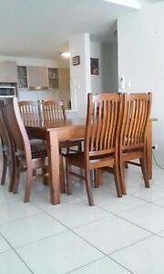 Solid wood 8 seater dining table and chairs North Ward Townsville City Preview