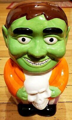 "Ceramic Halloween Frankenstein Monster Holding Skull Cookie Jar 8"""