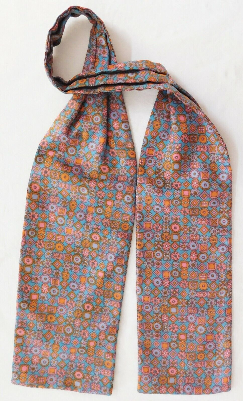 Smooth satin cravat with geometric pattern vintage 1960s menswear pastel colours