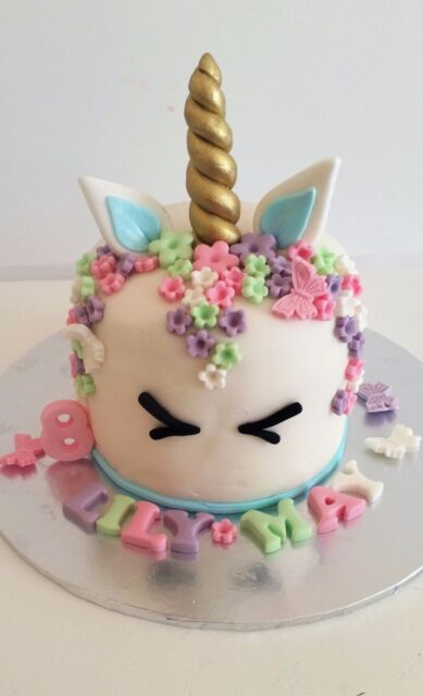 Edible unicorn horn ears eyes name age 80 flowers cake for How to make edible cake decorations at home