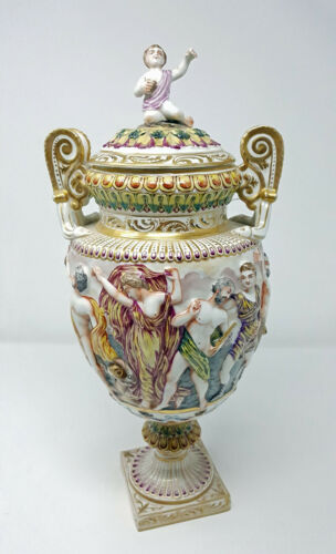 FRENCH CAPO DI MONTE STYLE PORCELAIN COVERED URNS WITH HIGH RELIEF FIGURAL GENRE
