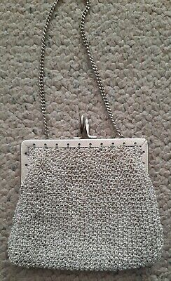 1950s Handbags, Purses, and Evening Bag Styles vintage small silver evening bag 1950's excellent condition silver metal frame $13.48 AT vintagedancer.com