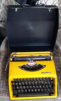 Typewriter: Canary Yellow ADLER Brand in almost new condition