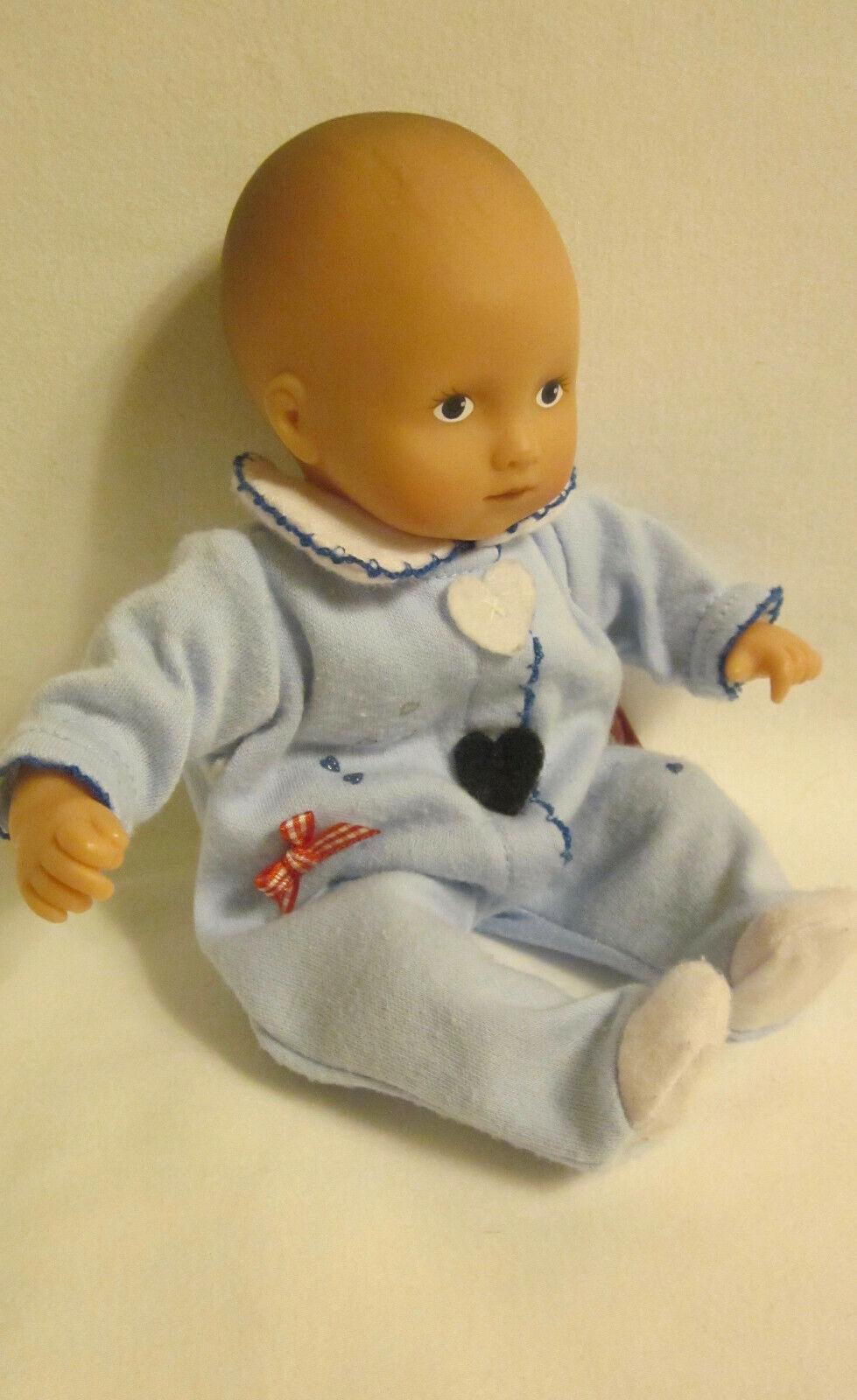 GOTZ MINI BABY DOLL, 9 , VINYL W/CLOTH BODY, WEARING ORIGINAL VERY CUTE SLEEPER - $11.99