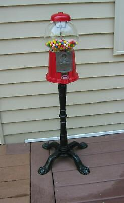 RED VINTAGE GUMBALL MACHINE ON METAL STAND