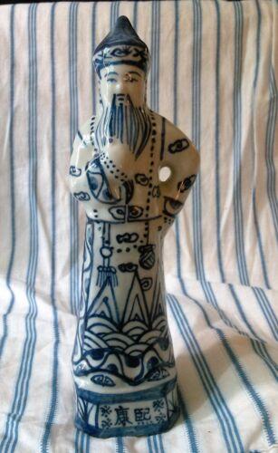 Procelain blue and white figurine Oriental man