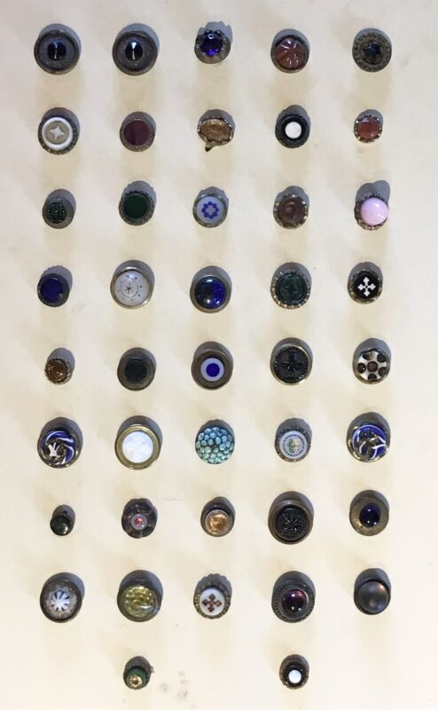 BEAUTIFUL CARD OF 42 ANTIQUE WAISTCOAT GLASS IN METAL BUTTONS