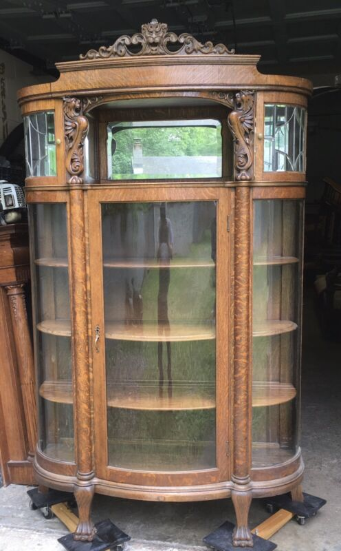 CARVED OAK GRIFFIN LEADED CHINA CABINET