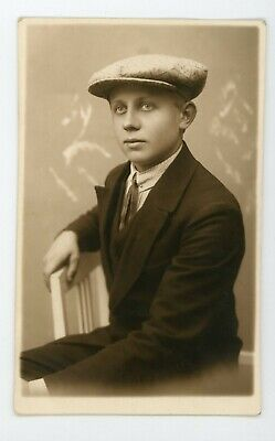 Dapper guy in cap & suit with pale eyes vintage antique RPPC Real photo postcard