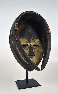 A Very fine Kwele African mask on display stand