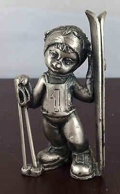 Vintage Pewter Figurine Child Holding Ski Board And Sticks -
