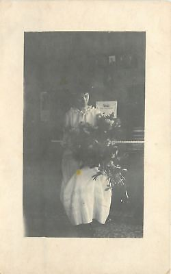 Vintage Real Photo Postcard~Victorian Lady Hold Flowers at Piano~1910 RPPC