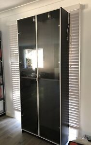 Bookcase with glass doors and lighting