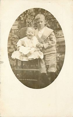 Vintage Real Photo Postcard~Victorian Boy With Baby Sis in High Chair~1908 RPPC