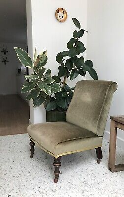 Antique nursing chair with wheels