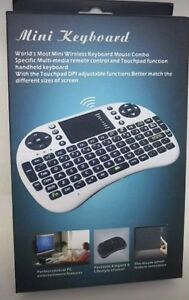 BRAND NEW IN THE BOX WIRELESS MINI REMOTE AND TOUCH PAD .