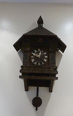 A FINE ANTIQUE BLACK FOREST CUCKOO CLOCK WITH BELL TOWER