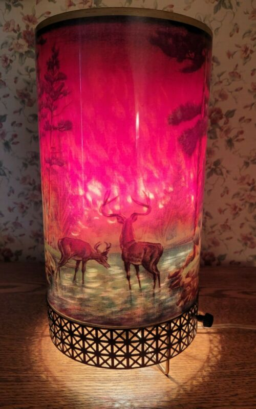 1956 Motion lamp with deer and forest fire.