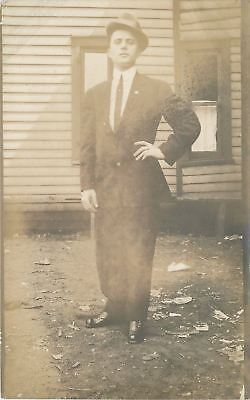 Paul Gruber~Peoria Illinois~In Suit~Hand on Hip~Nose Up~Trash Yard~1912 RPPC