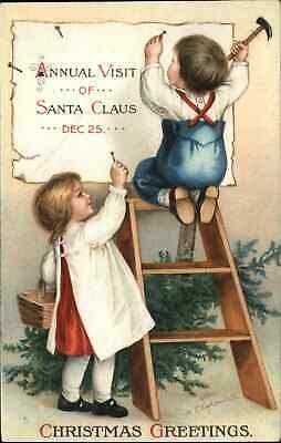 Christmas - Kids Hang Santa Claus Sign c1910 Ellen Clapsaddle Postcard